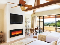 Resort Bedroom With Fireplace And Television